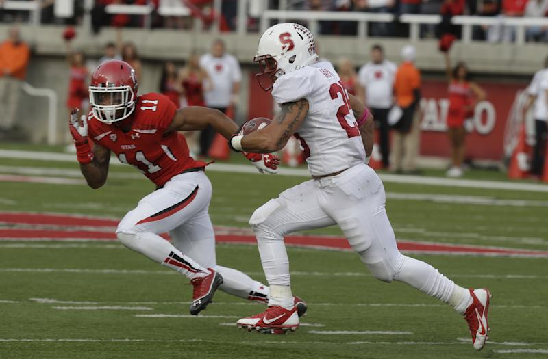Stanford running back Tyler Gaffney, right, carries the ball as Utah defensive back Davion Orphey (11) pursues during the first quarter of an NCAA college football game on Saturday, Oct. 12, 2013, in Salt Lake City. (AP Photo/Rick Bowmer)