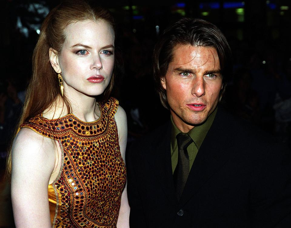 """Husband and wife, American actor Tom Cruise and Austrailian actress Nicole Kidman, before the UK premiere of their new film """"Eyes Wide Shut"""" directed by the Late Stanley Kubrick, at the Warner Village Cinema, Leicester Square in London.  * 05/02/01: The showbusiness couple announced they were separating, saying they were splitting because work was keeping them apart. 16/11/01: Tom Cruise and Nicole Kidman have agreed a private divorce settlement that will save them the embarrassment of a public court battle, it has emerged. Nine months after announcing their split, the Hollywood stars have """"come to an amicable, full resolution of all issues"""", according to a statement from their lawyers.   (Photo by Michael Crabtree - PA Images/PA Images via Getty Images)"""
