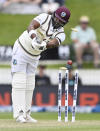 The West Indies' Darren Bravo is clean bowled by New Zealand's Kyle Jamieson during play on day three of their first cricket test in Hamilton, New Zealand, Saturday, Dec. 5, 2020. (Andrew Cornaga/Photosport via AP)