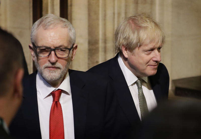 Britain's Prime Minister Boris Johnson, right, and opposition Labour Party Leader Jeremy Corbyn, left, walk through the Commons Members Lobby after hearing the Queen's Speech in Parliament, in London, Thursday, Dec. 19, 2019. Britain's parliament returns following the election, for the State Opening of Parliament. (AP Photo/Kirsty Wigglesworth, Pool)