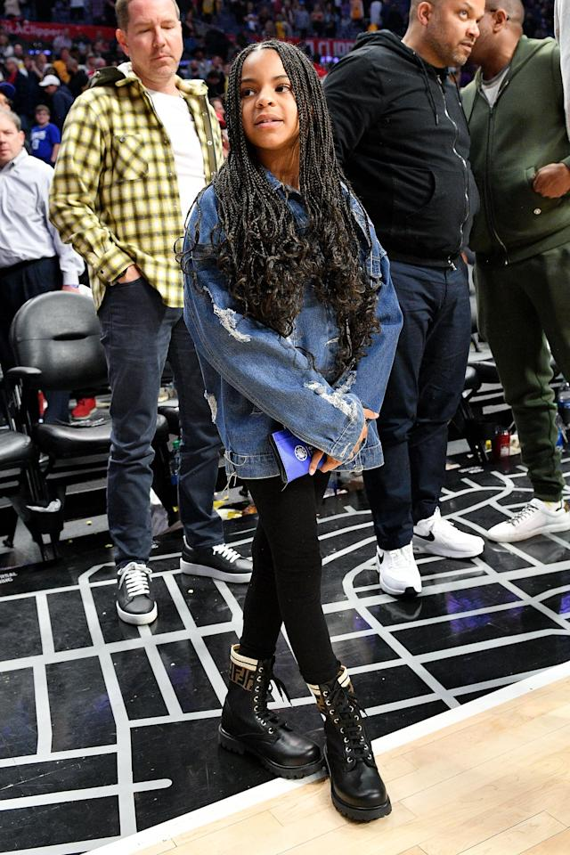 """<p>Blue Ivy proved she's a little fashionista in <a href=""""https://www.popsugar.com/fashion/blue-ivy-outfit-lakers-game-2020-47292324"""" class=""""ga-track"""" data-ga-category=""""Related"""" data-ga-label=""""https://www.popsugar.com/fashion/blue-ivy-outfit-lakers-game-2020-47292324"""" data-ga-action=""""In-Line Links"""">a custom denim jacket and Fendi boots</a>.</p>"""