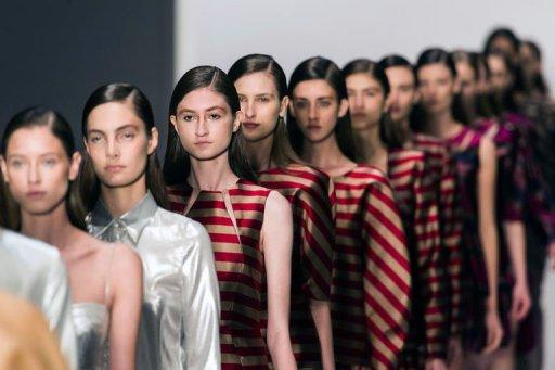 Models present creations by Vitorino Campos during the Sao Paulo Fashion Week 2013 winter collection in Sao Paulo, Brazil, on October 31