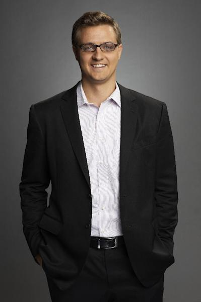 """Chris Hayes of MSNBC is seen in an udated photo provided by MSNBC. Hayes will replace Ed Schultz, who is losing his prime-time show on MSNBC. Schultz will be replaced weeknights by Hayes, whose talk show, """"Up,"""" has been a weekend morning mainstay on the MSNBC schedule since 2011. It begins April 1. The cable network says Schultz is being moved to the weekends, to host two-hour shows Saturday and Sunday at 5 p.m. EDT. (AP Photo/MSNBC)"""