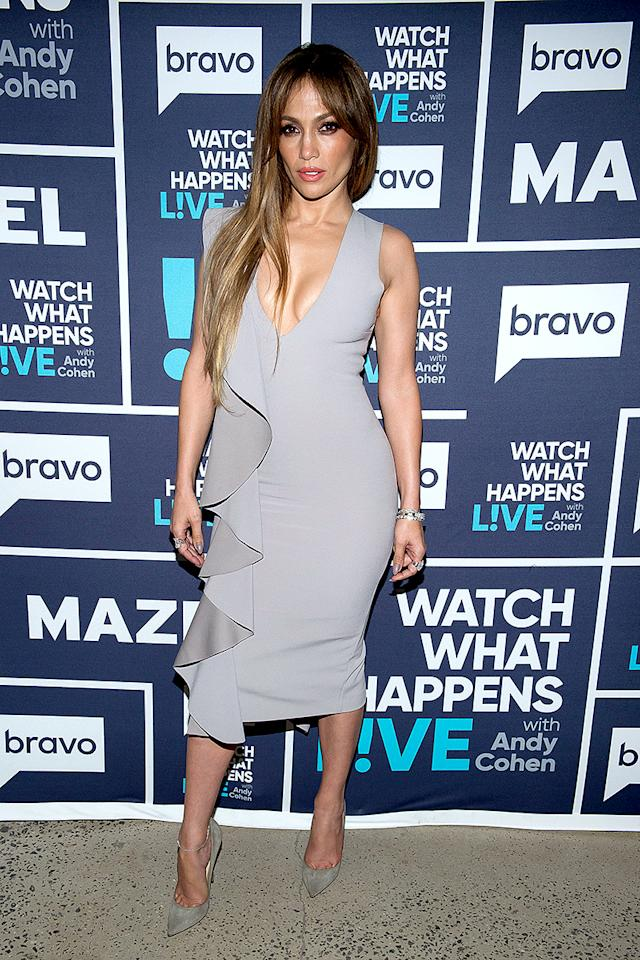 <p>The <em>Shades of Blue</em> beauty oozed sex appeal (as usual) in a gray Solace London creation with a plunging neckline and demure hem, while promoting her NBC show on <em>Watch What Happens Live</em>. (Photo: Charles Sykes/Bravo/NBCU Photo Bank via Getty Images) </p>