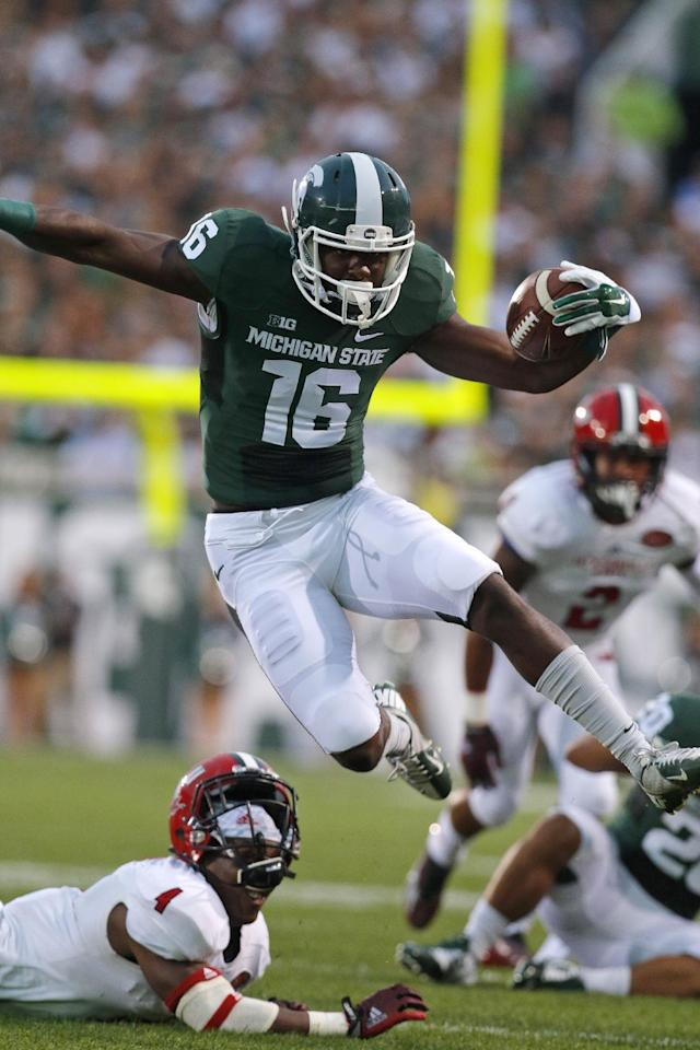 Michigan State's Aaron Burbridge (16) hurdles Jacksonville State's Folo Johnson (4) during the first quarter of an NCAA college football game, Friday, Aug. 29, 2014, in East Lansing, Mich. (AP Photo/Al Goldis)