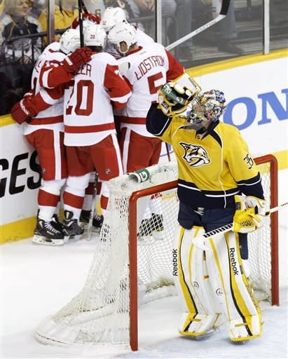 Nashville Predators goalie Pekka Rinne (35), of Finland, takes a drink as Detroit Red Wings players celebrate a goal by Cory Emmerton in the first period of Game 2 of an NHL hockey Stanley Cup first-round playoff series, Friday, April 13, 2012, in Nashville, Tenn. (AP Photo/Mark Humphrey)