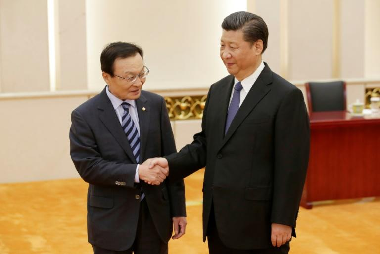 China's Xi says willing to help end rift with South Korea