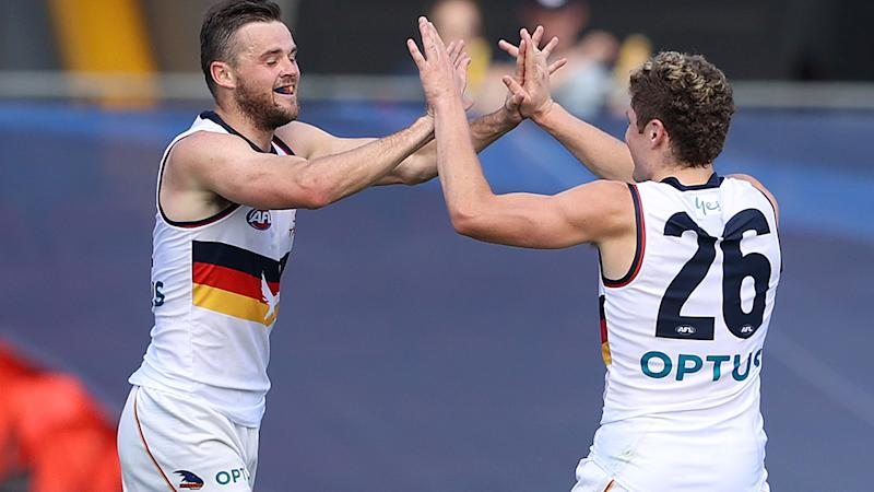 Brad Crouch, pictured here celebrates a goal for Adelaide against Carlton.