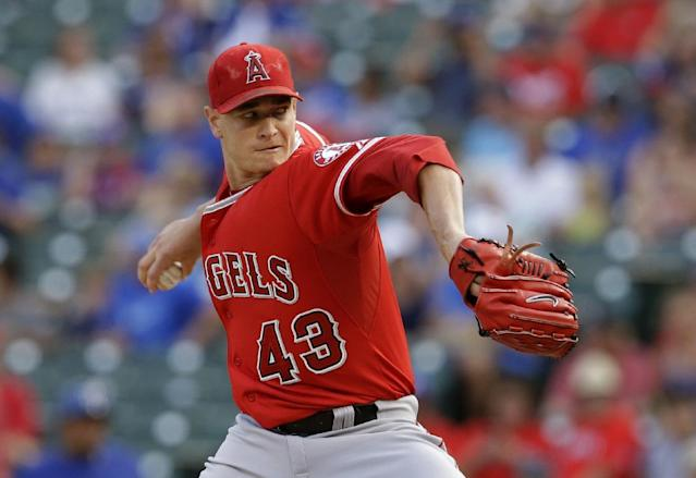 Los Angeles Angels starting pitcher Garrett Richards delivers to the Texas Rangers in the first inning of a baseball game, Friday, July 11, 2014, in Arlington, Texas. (AP Photo/Tony Gutierrez)