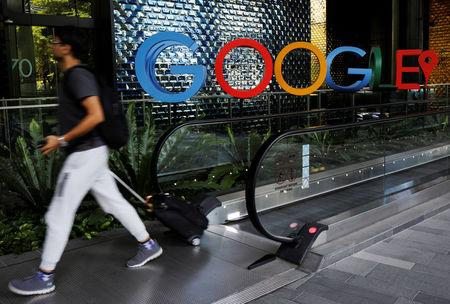 A man passes a Google signage outside their office in Singapore May 24, 2019. REUTERS/Edgar Su