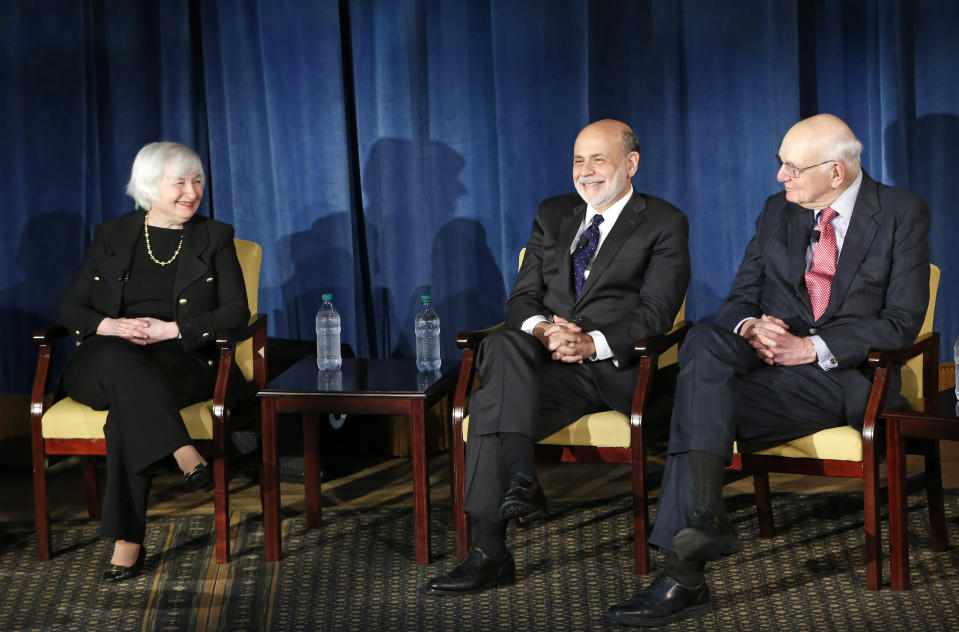 FILE - In this April 7, 2016, file photo from left, Federal Reserve chair Janet Yellen, and former Federal Reserve chairs Ben Bernanke, Paul Volcker appear together for the first time in New York. (AP Photo/Kathy Willens, Pool, File)