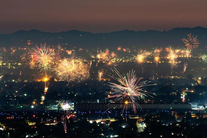 BURBANK, CA - JULY 04: Fireworks over North Hollywood, as seen from Burbank on Saturday, July 4, 2020 in Burbank, CA. (Kent Nishimura / Los Angeles Times)