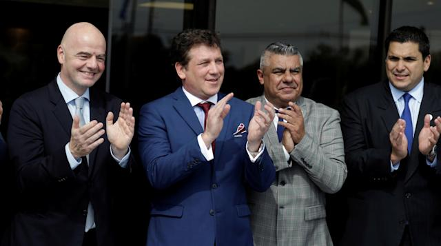 (L to R) FIFA President Gianni Infantino ,CONMEBOL President Alejandro Dominguez, Claudio Tapia, president of the Argentine Football Association (AFA) and Paraguayan Football Association President Robert Harrison attend the inauguration of a plaque of the new works in the Conmebol building, one day before at the 69th CONMEBOL Ordinary Congress at their headquarters in Luque, Paraguay May 10, 2018. REUTERS/Jorge Adorno