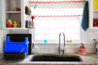 """<p>Get wet sponges and scrubbers off your countertop by <a href=""""https://www.goodhousekeeping.com/home/organizing/tips/g1397/small-kitchen-storage/?"""" rel=""""nofollow noopener"""" target=""""_blank"""" data-ylk=""""slk:placing them in desk organizers"""" class=""""link rapid-noclick-resp"""">placing them in desk organizers</a> hung on the side of nearby cabinets (an ever-underutilized space).</p><p><a href=""""http://homemadeginger1.blogspot.com/2014/05/kitchen-sink-organization.html"""" rel=""""nofollow noopener"""" target=""""_blank"""" data-ylk=""""slk:Get the tutorial at Homemade Ginger »"""" class=""""link rapid-noclick-resp""""><em>Get the tutorial at Homemade Ginger »</em></a></p>"""