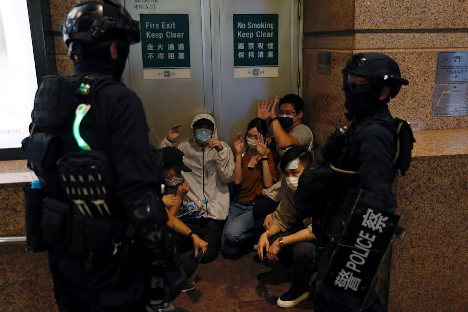 Riot police detain people protesting against new security law: REUTERS