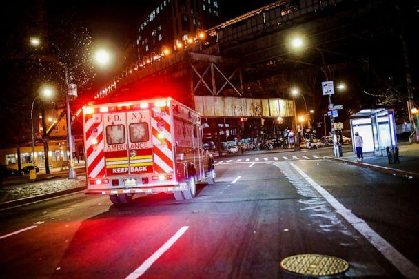 PHOTO: FDNY paramedic Elizabeth Bonilla drives to an emergency call along an empty street on her second consecutive shift on April 15, 2020, in the Bronx borough of New York City. (John Minchillo/AP)