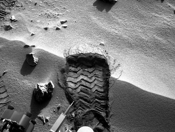 "NASA's Mars rover Curiosity cut a wheel scuff mark into a wind-formed ripple at the ""Rocknest"" site to give researchers a better opportunity to examine the particle-size distribution of the material forming the ripple. The rover's right Navigat"
