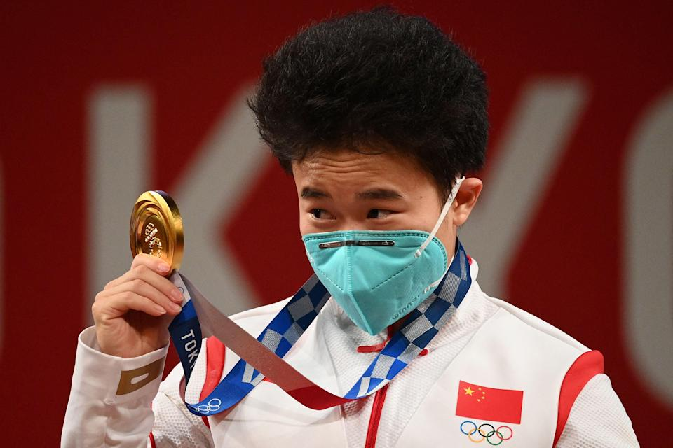 China's Hou Zhihui stands on the podium after winning gold (AFP)