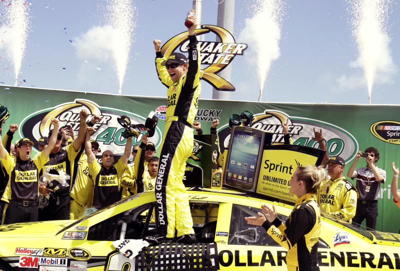 Matt Kenseth celebrates with his crew members in the winner's circle after capturing the NASCAR Sprint Cup auto race at Kentucky Speedway in Sparta, Ky., Sunday, June 30, 2013. (AP Photo/Garry Jones)