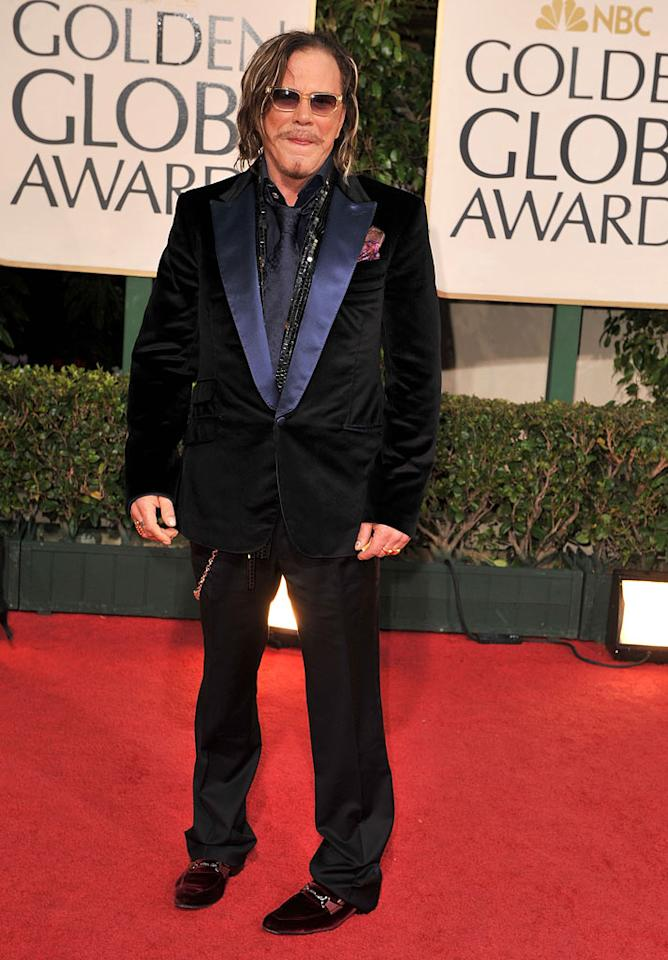 """Best Actor winner Mickey Rourke rocked a repulsive getup, along with a dirty head of hair, a sequined scarf, and a truly tacky wallet chain. Steve Granitz/<a href=""""http://www.wireimage.com"""" target=""""new"""">WireImage.com</a> - January 11, 2009"""