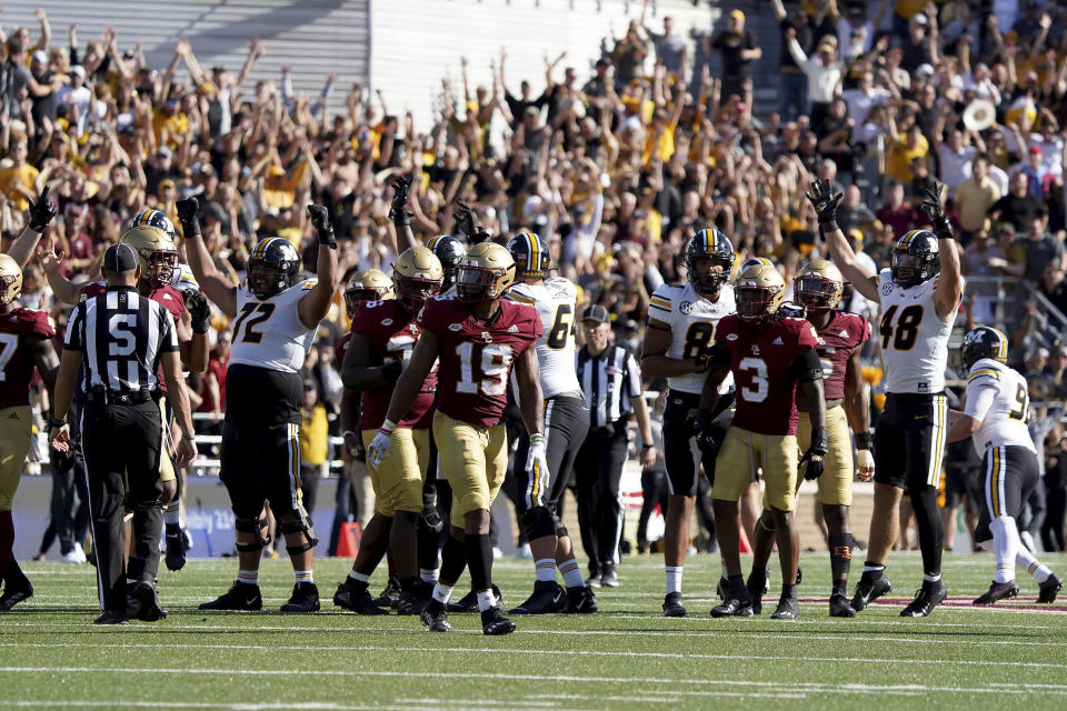 Missouri players celebrate as Boston College players look on after Missouri place kicker Harrison Mevis kicked a field goal to tie the game as time expired during the second half of an NCAA college football game, Saturday, Sept. 25, 2021, in Boston. (AP Photo/Mary Schwalm)