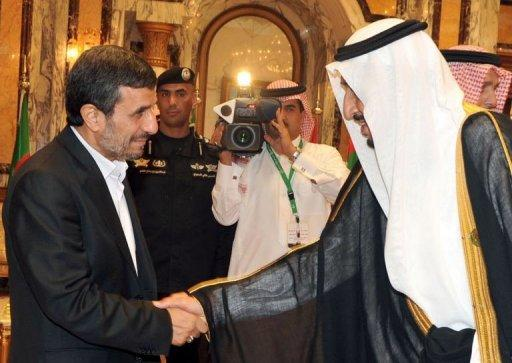 Saudi's Crown Prince Salman Ibn Abdul Aziz greeting Iranian President Mahmoud Ahmadinejad (L) upon his arrival in the Saudi city of Mecca to attend an Islamic summit. The Islamic summit meeting announced the suspension of Syria from the 57-member Organisation of Islamic Cooperation (OIC)