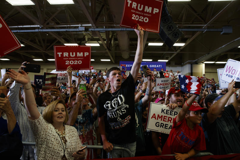 Supporters of President Donald Trump cheer as he arrives on stage at the Crown Expo for a campaign rally, Monday, Sept. 9, 2019, in Fayetteville, N.C. (AP Photo/Evan Vucci)