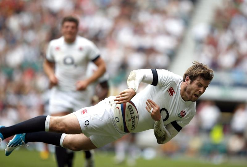 England's full back Elliot Daly dives to keep the ball off the sideline during the Rugby Union match against the Barbarians in London June 1, 2014 (AFP Photo/Adrian Dennis)
