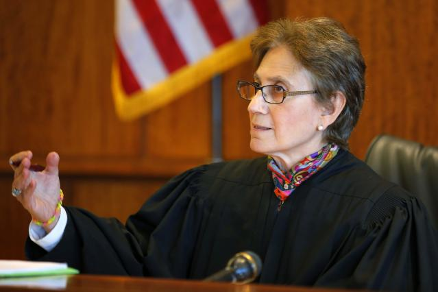 Judge Susan Garsh speaks during a pre-trial hearing in the case of Aaron Hernandez, former player for the NFL's New England Patriots football team, at the Bristol County Superior Court in Fall River, Massachusetts October 9, 2013, in connection with the death of semi-pro football player Odin Lloyd in June. Hernandez, who was a rising star in the NFL before his arrest and release by the Patriots, has pleaded not guilty. REUTERS/Brian Snyder (UNITED STATES - Tags: CRIME LAW SPORT FOOTBALL)
