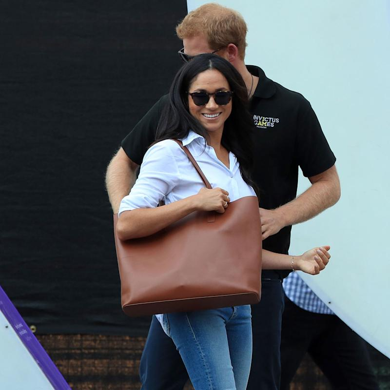 803cdca7d6 Meghan Markle Carries the Same Chic (and Affordable) Tote as Angelina Jolie
