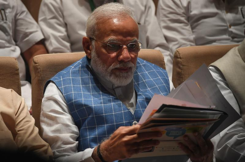India Prime Minister Narendra Modi reads a document during a Bhartiya Janata Party (BJP) Parliamentary Committee meeting at the Parliament house in New Delhi on July 23, 2019. - India's foreign ministry on July 22 denied US President Donald Trump had been asked by Indian Prime Minister Narendra Modi to mediate the Kashmir conflict with Pakistan. (Photo by Prakash SINGH / AFP) (Photo credit should read PRAKASH SINGH/AFP/Getty Images)