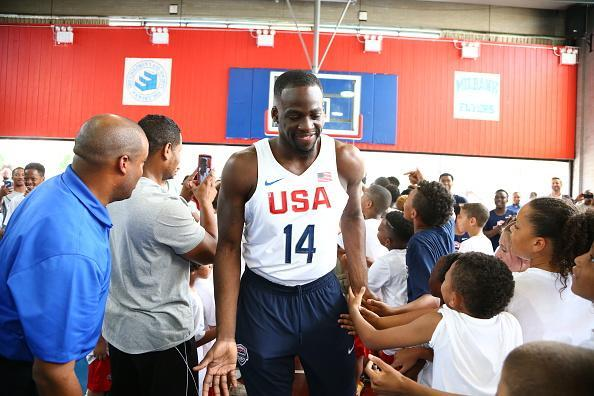 Draymond Green greets children during a recent USA Basketball event in New York City. (Nathaniel S. Butler/Getty Images)