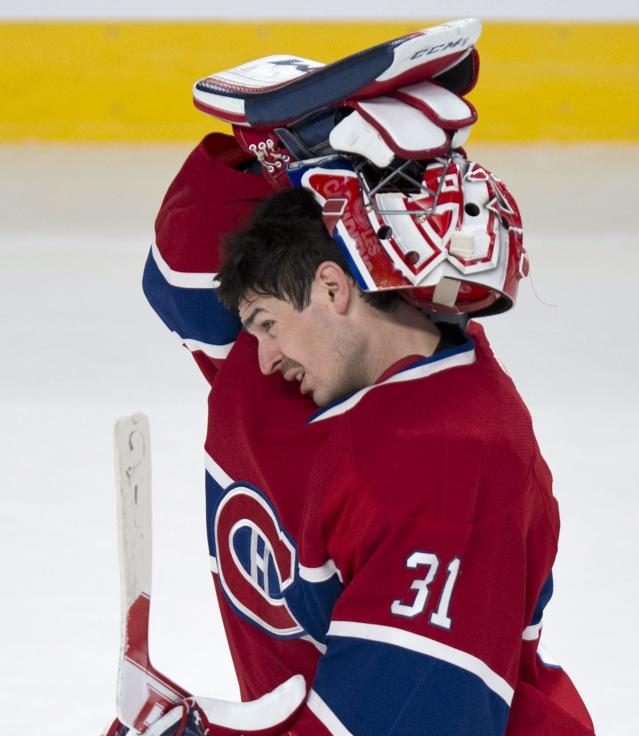 Montreal Canadiens goalie Carey Price puts his face mask on as he skates back to his net during the second period of an NHL hockey game against the Tampa Bay Lightning on Tuesday, Nov. 12, 2013, in Montreal. (AP Photo/The Canadian Press, Paul Chiasson)