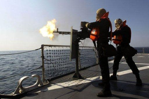 """Iranian navy officers take part in the """"Velayat-90"""" naval wargames in the Strait of Hormuz in southern Iran, on January 1. Iran on Monday tested missiles near the Strait of Hormuz, underlining its threats to close the vital oil-transit waterway as the West readies to impose more economic sanctions over Tehran's nuclear drive"""