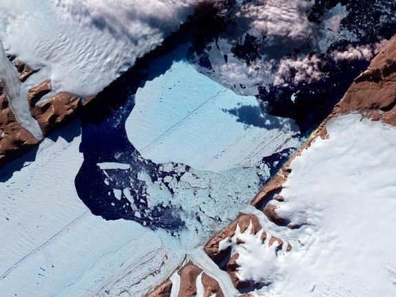 In July 2012, a massive ice island broke free of the Petermann Glacier in northwestern Greenland. On July 21, 2012, the Advanced Spaceborne Thermal Emission and Reflection Radiometer (ASTER) on NASA's Terra satellite captured this image of the