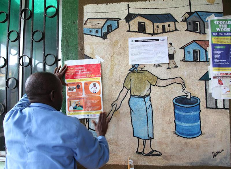 A nurse posts information about Ebola on a wall of a public health center on July 31, 2014 in Monrovia, Liberia (AFP Photo/)