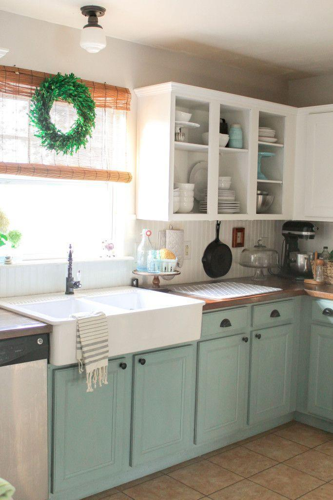 """<p>Opening one cupboard, then adding chalk paint and new hardware left these cabinets looking lovely.</p><p><strong>Get the tutorial at <a href=""""http://www.ourstoriedhome.com/chalk-painted-kitchen-cabinets-2-years-later/"""" rel=""""nofollow noopener"""" target=""""_blank"""" data-ylk=""""slk:OurStoriedHome.com"""" class=""""link rapid-noclick-resp"""">OurStoriedHome.com</a>.</strong></p><p><strong><a class=""""link rapid-noclick-resp"""" href=""""https://www.amazon.com/s?i=aps&k=open+shelving&ref=nb_sb_noss_1&url=search-alias%3Daps&tag=syn-yahoo-20&ascsubtag=%5Bartid%7C2139.g.34085615%5Bsrc%7Cyahoo-us"""" rel=""""nofollow noopener"""" target=""""_blank"""" data-ylk=""""slk:SHOP OPEN SHELVING"""">SHOP OPEN SHELVING</a><br></strong></p>"""