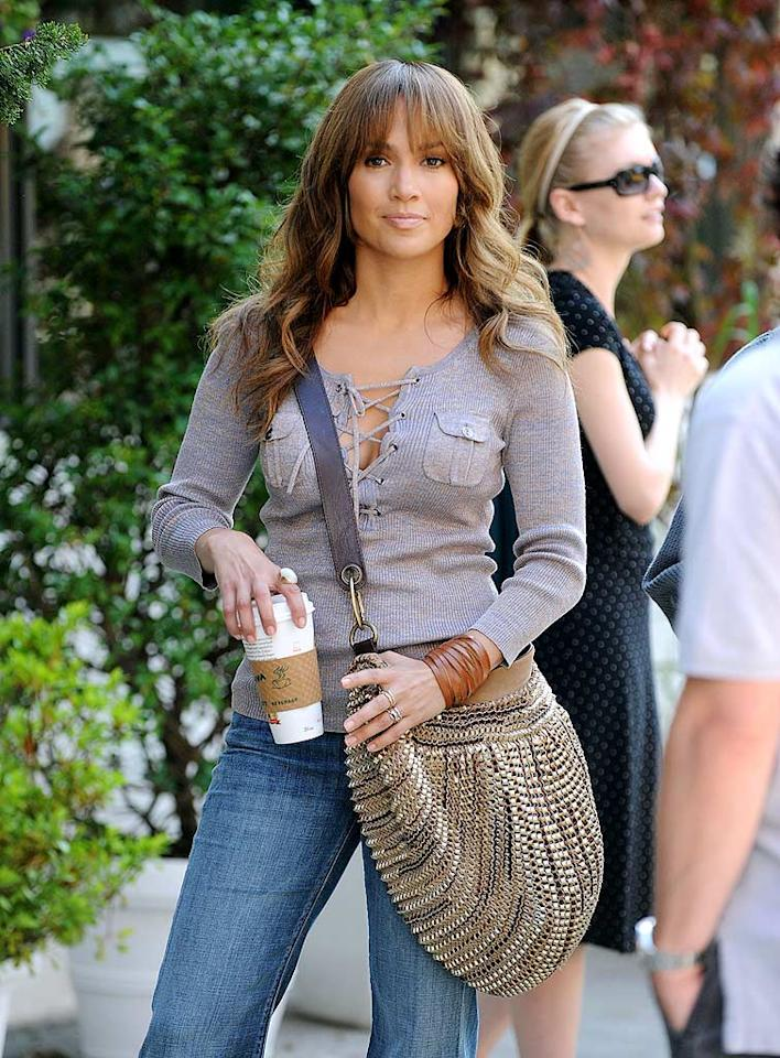 """You won't find J.Lo's new film, """"The Back-Up Plan,"""" in theaters until January, but you can find the gold Diane von Furstenberg hobo bag she carries in the film for purchase online. James Devaney/<a href=""""http://www.wireimage.com"""" target=""""new"""">WireImage.com</a> - July 17, 2009"""