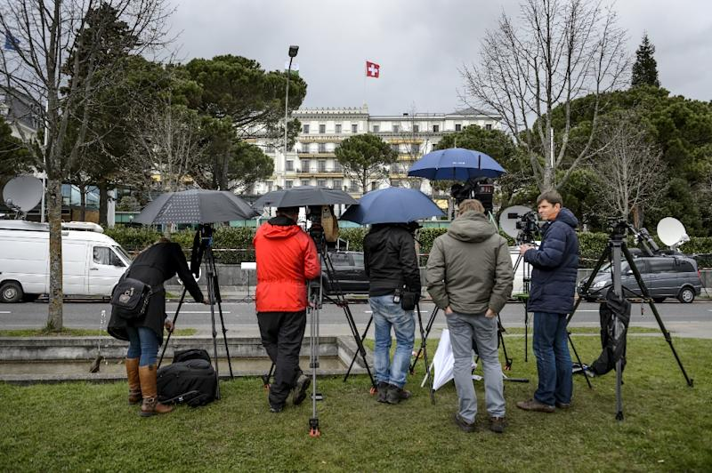 A TV crew waits in front of the hotel Bean-Rivage Palace during Iran nuclear talks in Lausanne on March 31, 2015
