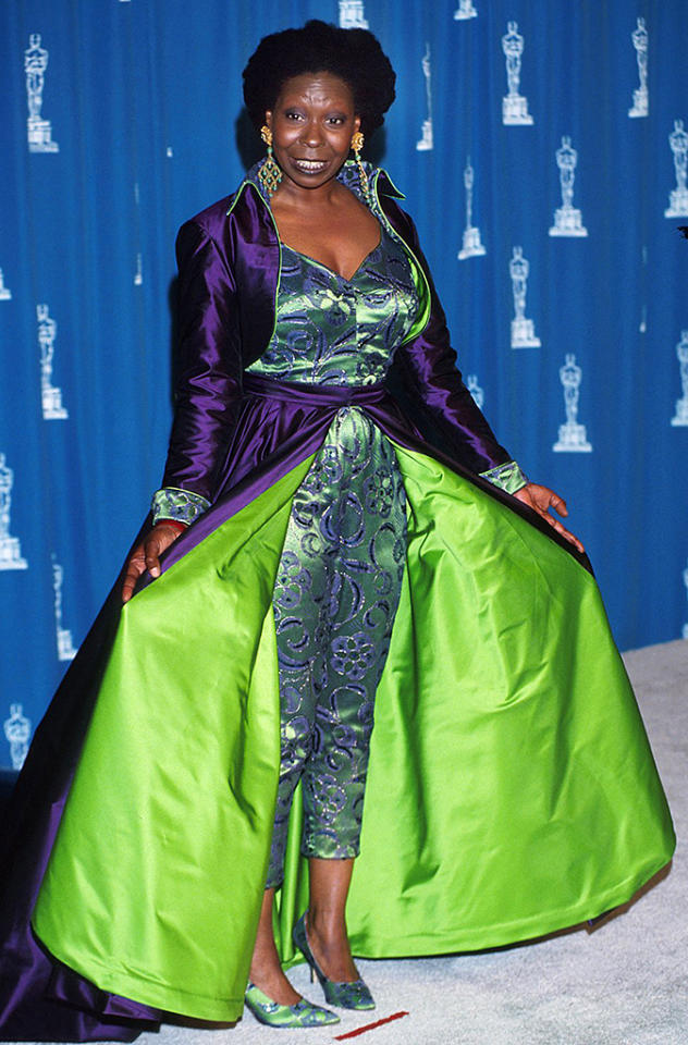 "Whoopi Goldberg, 1993. Look, she's a comedian, we understand. Her crowning achievement was in ""The Color Purple."" But a comic take on purple is not Oscar apropos: Abstract floral purple patterns swirled on a green jumpsuit, over which she wore a collared dress cape, purple on the outside, lime green on the very visible inside. Was it reversible? How did she use the ladies' facilities? The mind reeled."