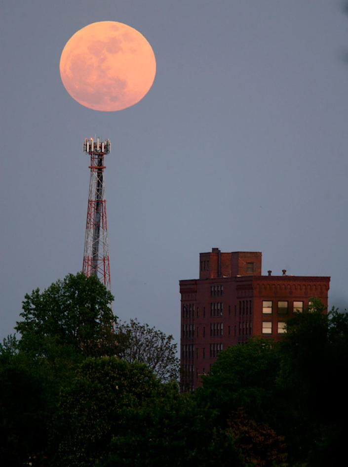 """The """"supermoon"""" rises over the Renkert Building, Saturday, May 5, 2012 in Canton, Ohio. The biggest and brightest full moon of the year arrives Saturday night, May 5 as our celestial neighbor passes closer to Earth than usual."""