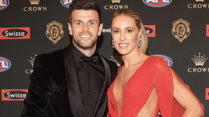 Trent Cotchin of the Tigers and Brooke Cotchin smile for a photo at the 2018 Brownlow Medal.
