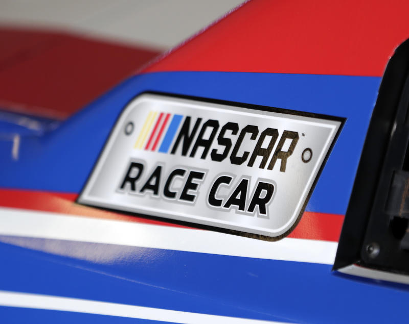 A NASCAR logo on a car is seen in the garage during a NASCAR auto racing practice session at Daytona International Speedway, Saturday, Feb. 10, 2018, in Daytona Beach, Fla. (AP Photo/John Raoux)