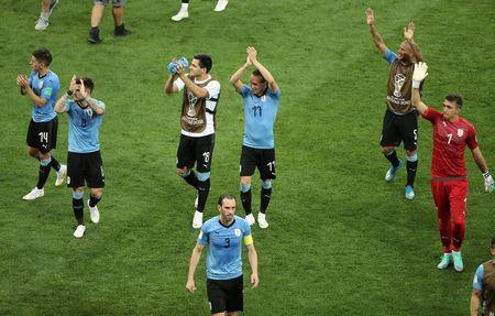 Soccer Football - World Cup - Group A - Uruguay vs Saudi Arabia - Rostov Arena, Rostov-on-Don, Russia - June 20, 2018 Uruguay players applaud fans after the match REUTERS/Marcos Brindicci