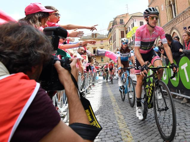 Britain's Simon Yates wears the pink jersey of the overall leader at the start of the 12th stage of the Giro dItalia cycling race from Osimo to Imola, Italy, Thursday, May 17, 2018. (Daniel Dal Zennaro/ANSA via AP)