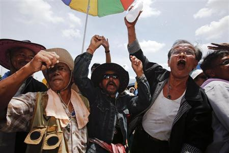 Rubber farmers shout slogans at their gathering place during protests in Surat Thani September 4, 2013. REUTERS/Athit Perawongmetha