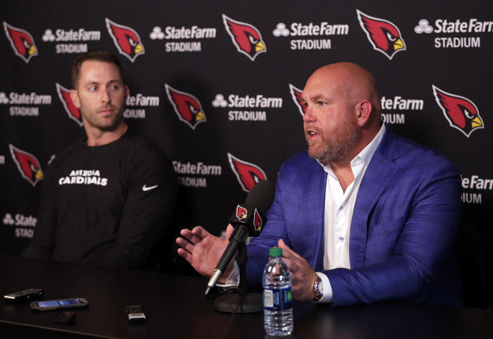 FILE - Arizona Cardinals head coach Kliff Kingsbury, left, and general manager Steve Keim discuss the upcoming NFL football draft during a news conference in Tempe, Ariz., in this Tuesday, April 16, 2019, file photo. They'll pick at No. 16 spot in the first round of the NFL Draft, April 29-May 1, 2021, and seem likely to target a defensive player, particularly a cornerback. (AP Photo/Matt York, File)