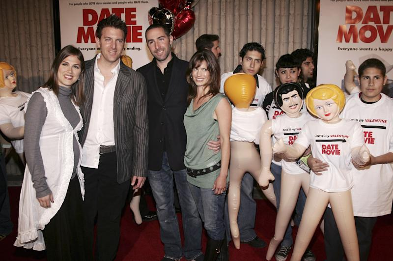 """LOS ANGELES - FEBRUARY 13: Writers Jason Friedberg (left) and Aaron Seltzer and their wives attend radio station KROQ's """"Valentine's Day Singles"""" screening of 20th Century Fox's comedy """"Date Movie"""" on February 13, 2006 in Los Angeles, California. Guests arrive with inflatable """"dates"""" at right. (Photo by Vince Bucci/Getty Images)"""