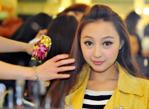 """Chinese native Qi Ji has her make-up done during a new talent show """"Asian Idol Group Competition"""" in Taipei, in May. Growing numbers of young Chinese performers are eschewing the entertainment scene at home and instead coming to Taiwan in the hope of getting a big break"""