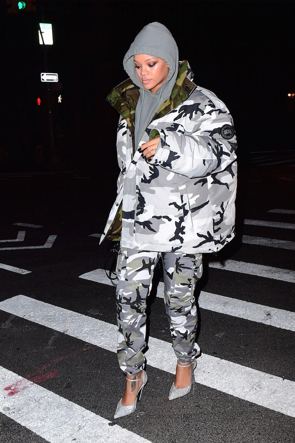 <p>In a Vetements x Canada Goose camo jacket, matching camo pants, a grey hoodie and silver heels while out in New York City.</p>